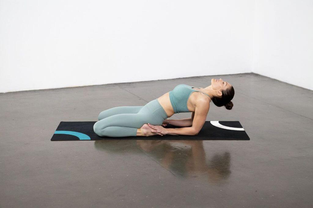 Fish Out of Hero Pose (Matsyendra Virasana) - Yoga Pose