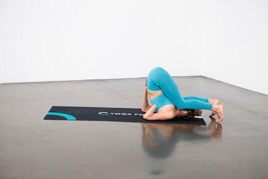 Plow Pose (Halasana) - Yoga Pose