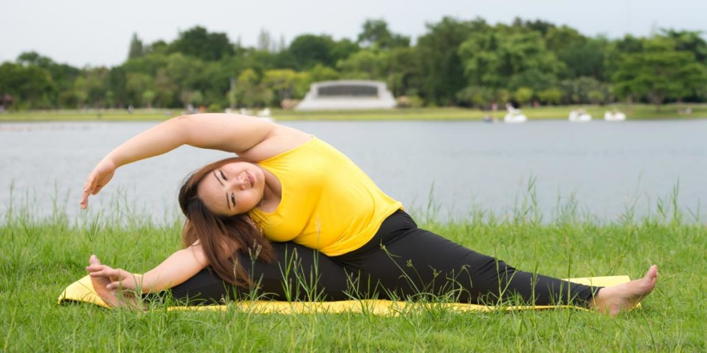 woman-practicing-yoga-outside