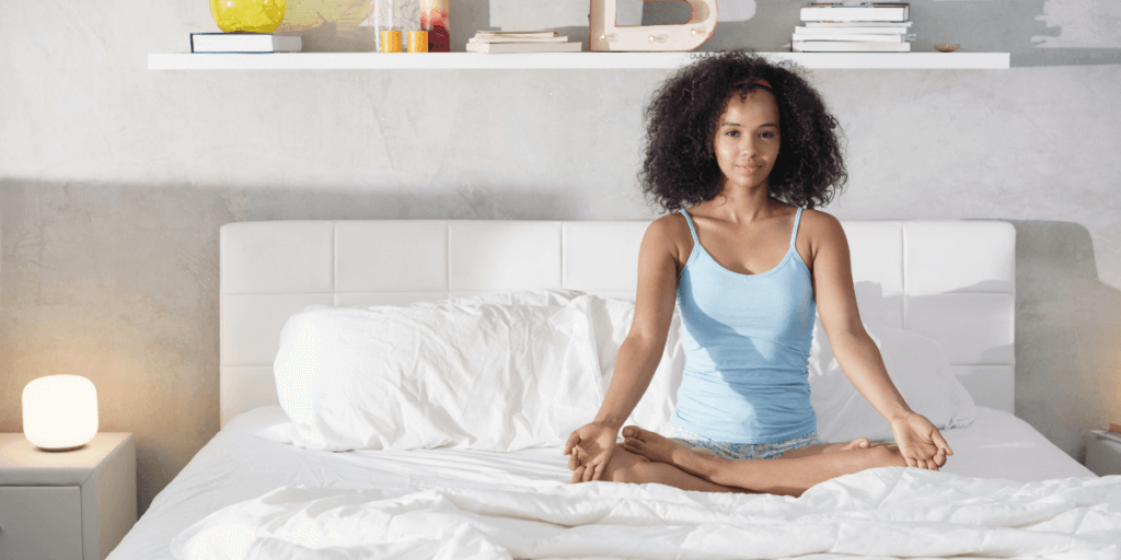 black-woman-practicing-yoga-in-bed