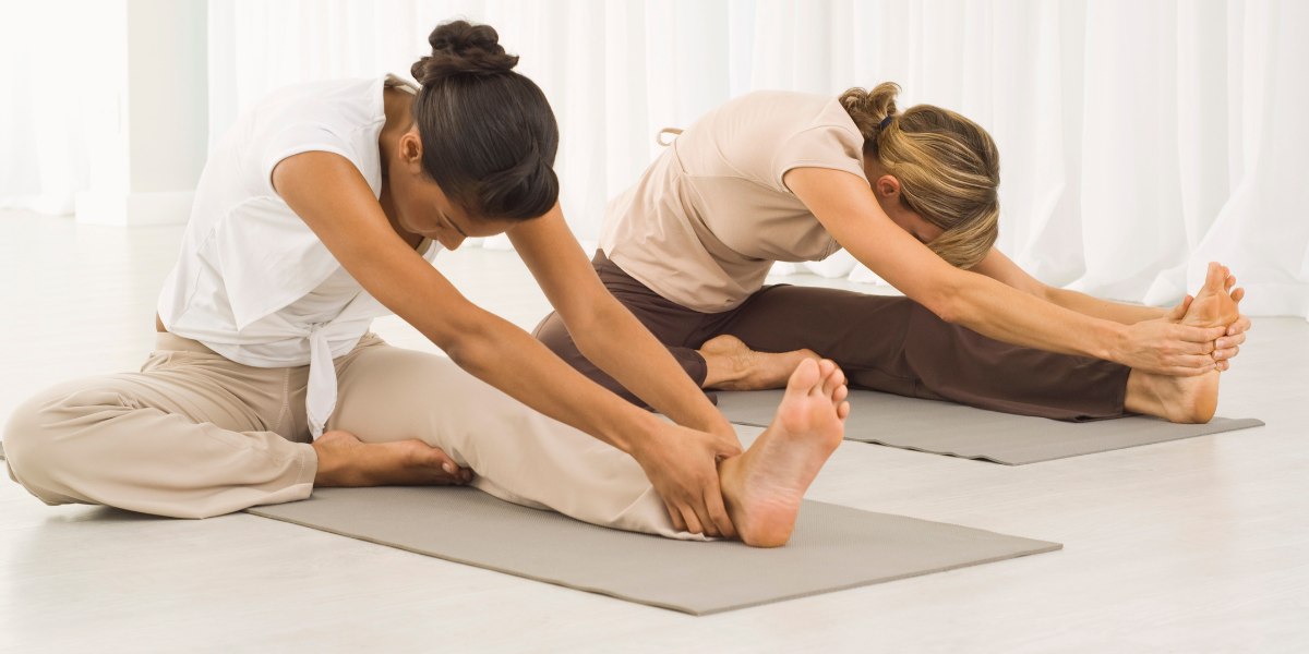 two-women-practicing-yoga