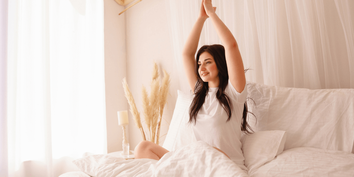 woman-practicing-yoga-in-bed