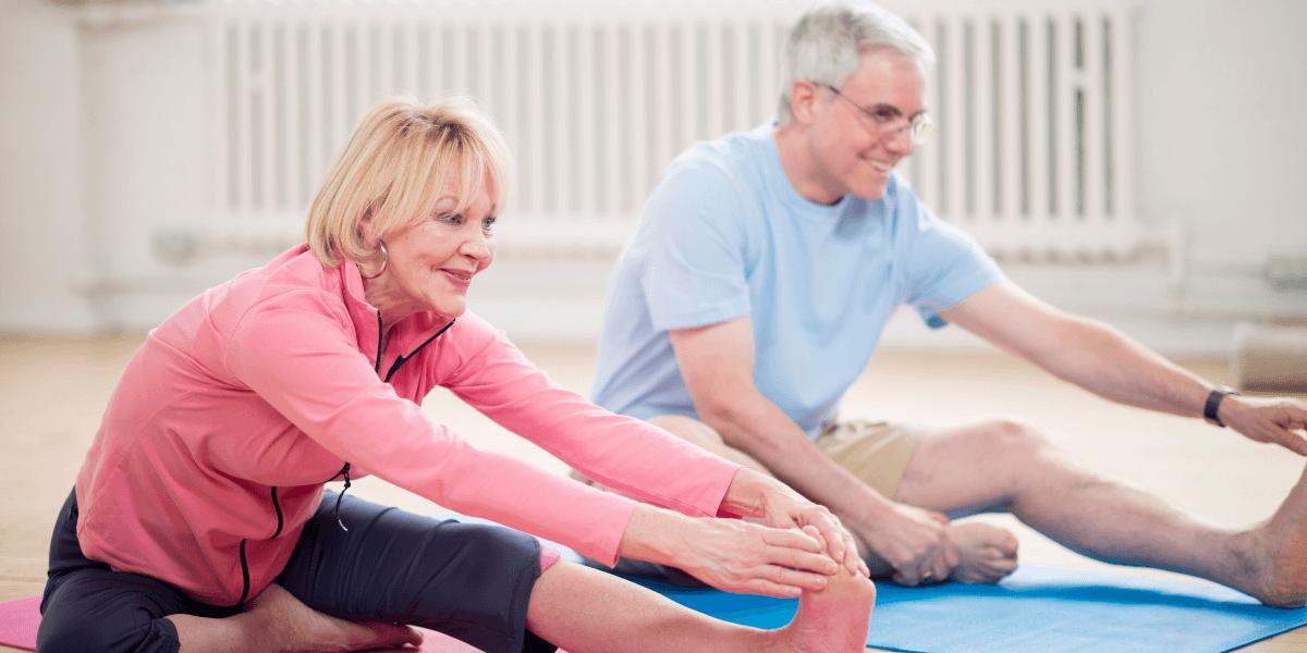elderly-couple-practicing-yoga