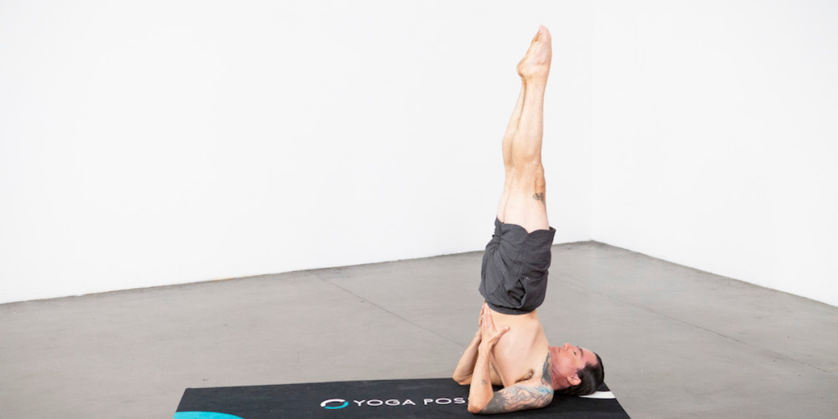 man-practicing-supported-shoulder-stand