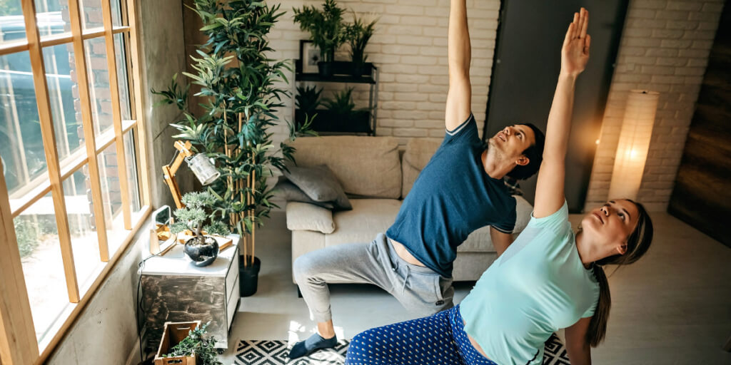 couple-practicing-yoga-at-home