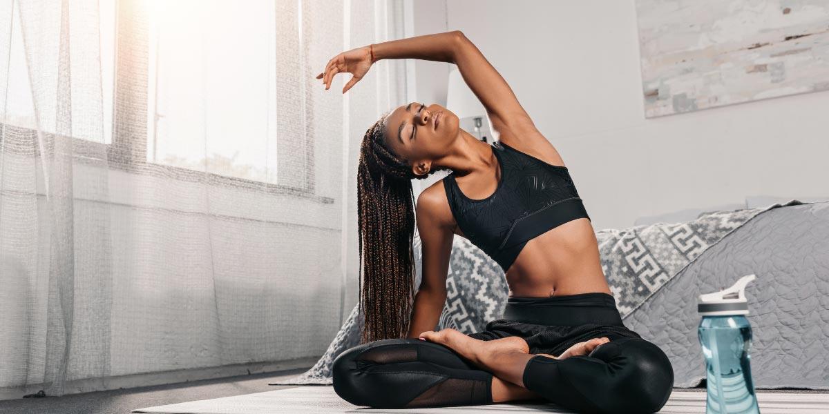 black-woman-practicing-yoga-at-home