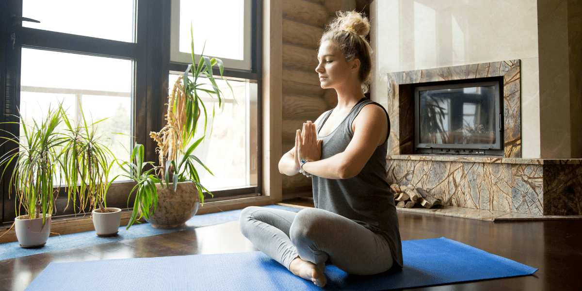 woman-practicing-yoga-in-the-morning