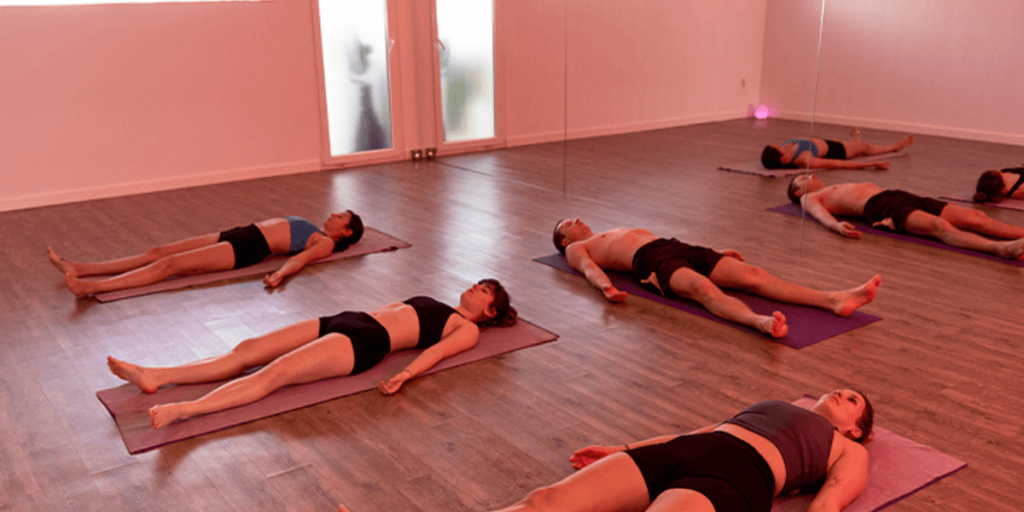 Hot yoga is simply doing yoga in a room that is heated to a higher-than-average temperature, usually between 80°F to 100°F.