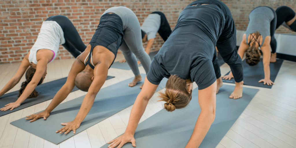 Down dog, also known as the downward-facing dog, is a beginner-level posture that targets your calves, hamstrings, and other muscles. It stretches out your legs and creates space between your shoulders and spinal vertebrae.