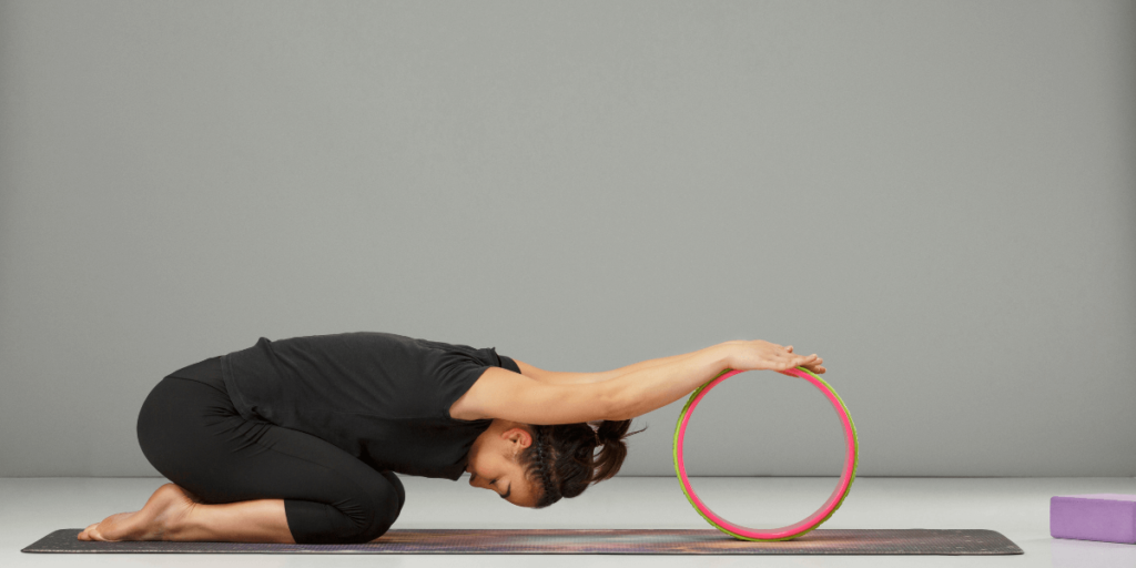 Wheel-Assisted Child's Pose